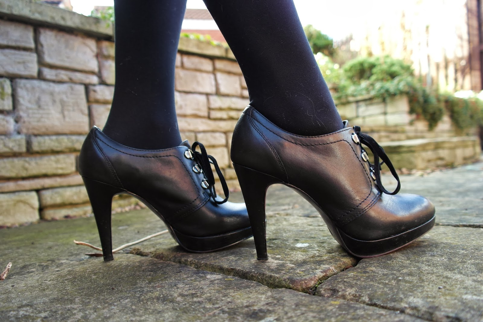 black leather platform stilettos