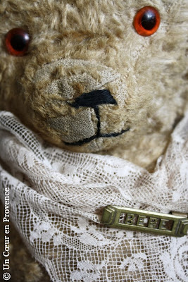 Detail of a worn face teddy bear