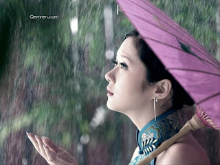 beautiful girl with purple umbrella in rain