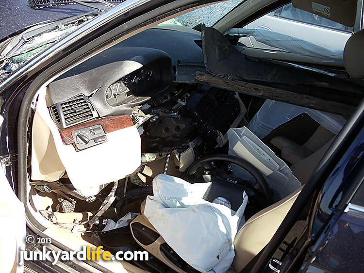 2003 BMW 325i head-on collision drivers side interior photo.