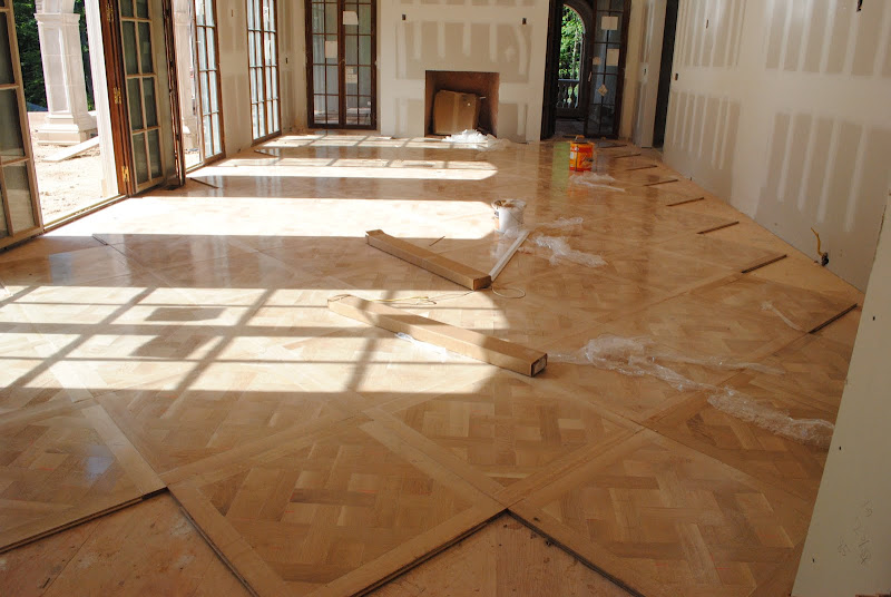 Then the living room Versailles Parquet floor started getting put in  title=