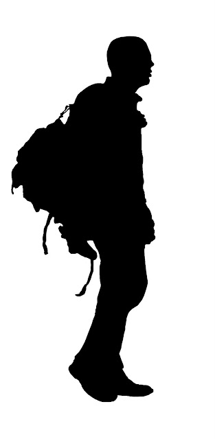 silhouette of man with backpack