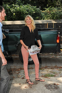 Kate Upton holding newspaper