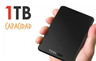 disco duro portatil toshiba de 1tb (terabyte) en mano