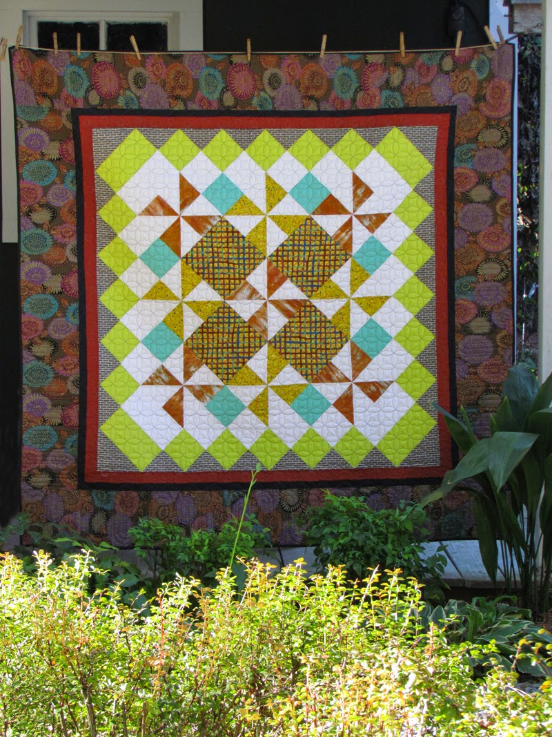 A quilt by Marty Mason.....It's hip to be square.