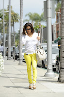 Eva Longoria wearing yellow pants