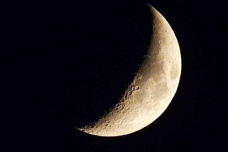 33 percent visible, crescent moon, craters