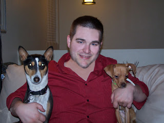 Jared Connell with his two dogs, a Basenji and a Miniature Pinscher