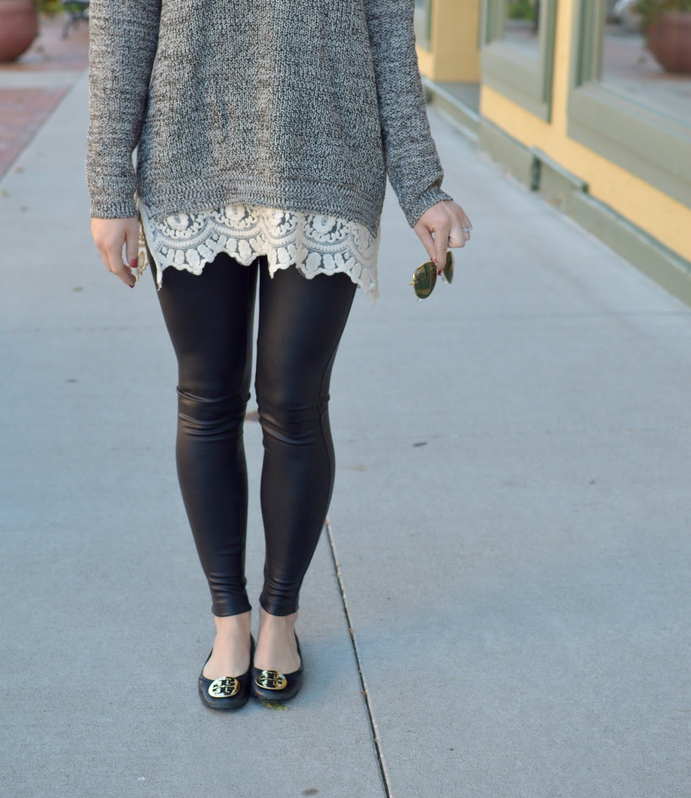 cozy sweater with leather leggings