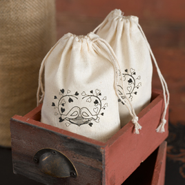 http://allstyleweddings.com/Wedding-Favors/Practical-Wedding%20Favors/Cotton-Favor-Bags-Love-Birds