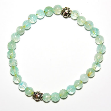 Aquamarine with lucky Charm