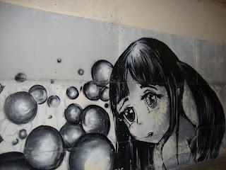 Sad girl Graffiti - Sant Carles de La Rápita - Spain