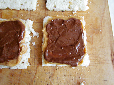 Overhead shot of bread with peanut butter and nutella on it