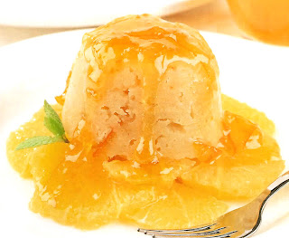 steamed marmalade pudding on a bed of sliced oranges