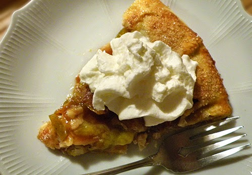 Slice of Plum Galette with Whipped Cream