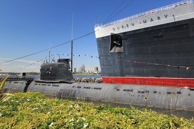 USS Scorpion Submarine is parked next to the legendary Queen Mary's cruise ship at Long Beach, Los Angeles, California, USA