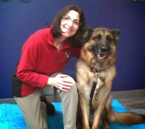Ms. Ellen Agler with her therapy dog Lancer, a German Shepherd