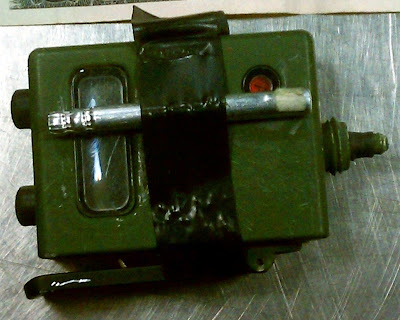 "M147 Firing Device - While resolving a checked baggage alarm on a bag at Reno (RNO), Officers found an initiator, an M147 firing device with the words, ""Danger Blasting Cap Explosive"" stenciled on the side"