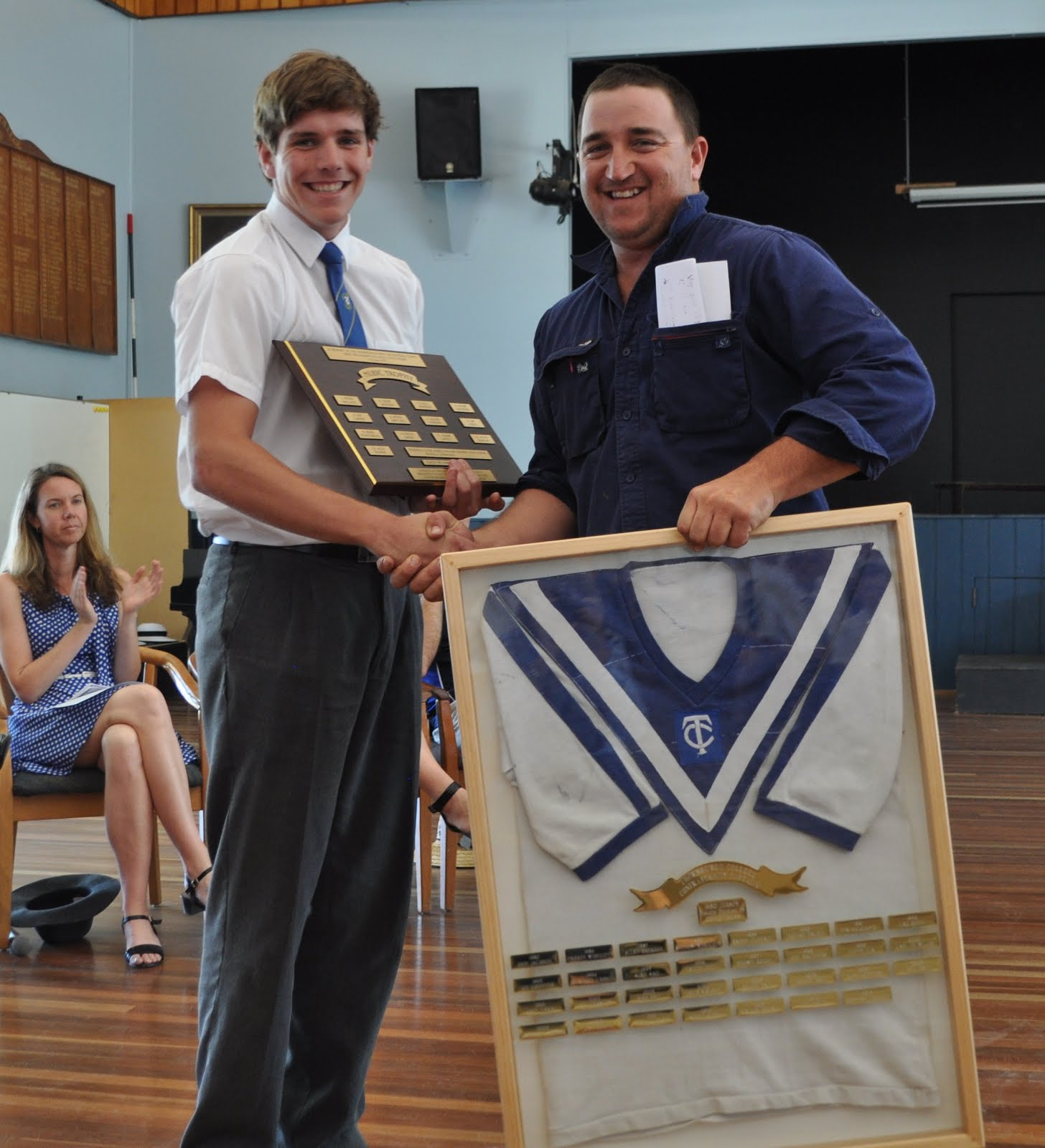 Max Batt Presents Brennan Leggett with Nubic Trophy & Original Jersey from Inaugural Confraternity