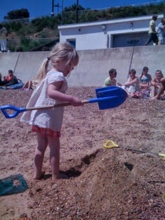 girl digging on beach