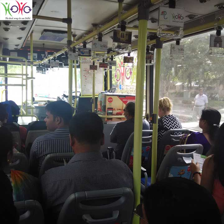tourists seating in HOHO Bus