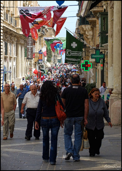 Strolling tourists crowd downtown Valletta Malta