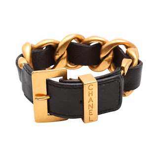 Vintage 1990's gold and black leather Chanel buckle bracelet.