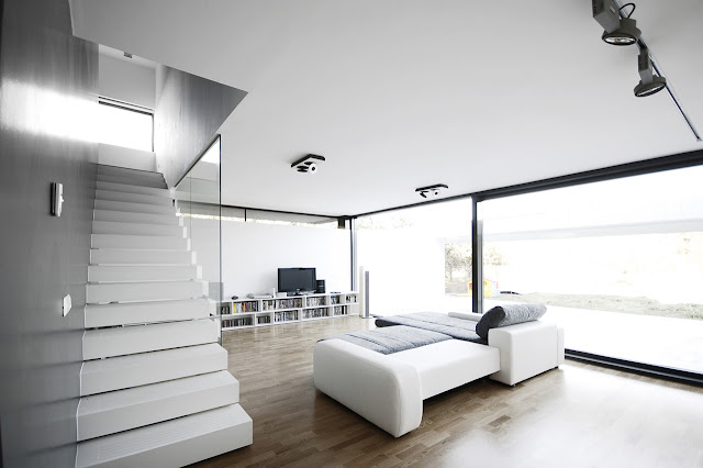 Minimal living room with white furniture