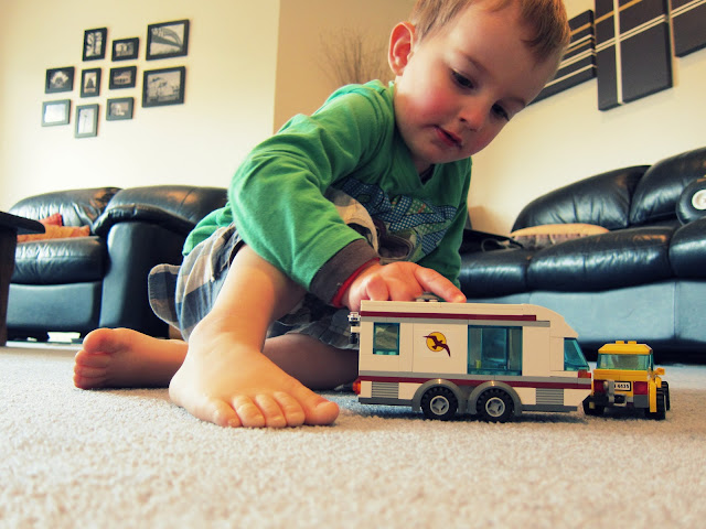 Engrossed in play with the LEGO City Car & Caravan