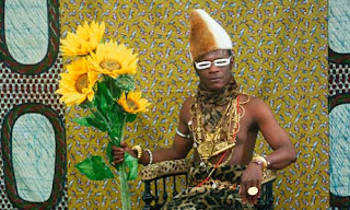 Self portrait as an African Chief by Samuel Fosso. Detailed description follows in caption.