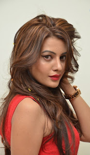 Diksha Panth in a Spicy Red Sleelvess Kurti new Dyed Hairstyle Spicy pics