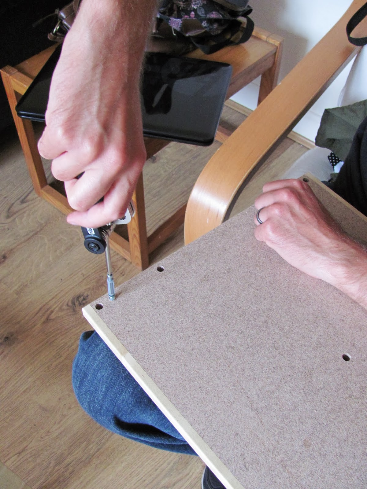 Assembling LAIVA TV stand from IKEA Dublin, Ireland with a screwdriver from a bicycle repair kit.