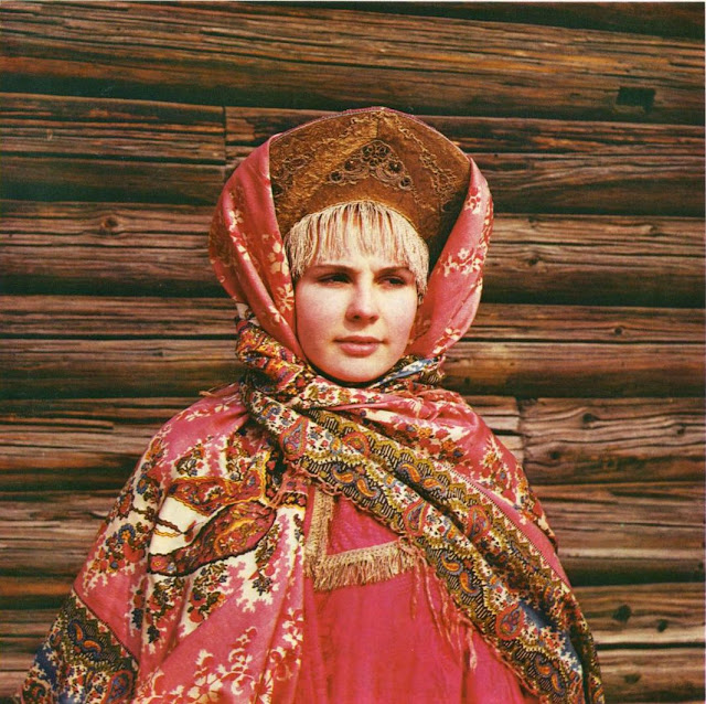 Russian woman dressed in traditional costume with kokoshnik and shawl