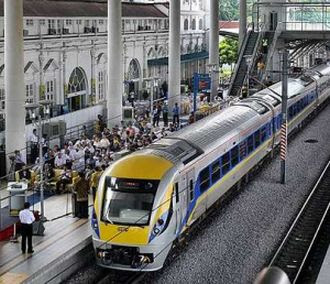 Rail convenience: A KTM train at the Ipoh Railway Station Thursday where ERL tickets to KLIA are now available for purchase.