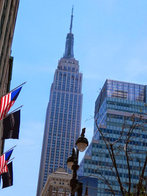 new york city empire state building tree lamp sunny light