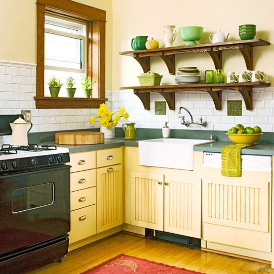 These dark wood kitchen shelves float over the sink and are scattered with vibrant green dishes
