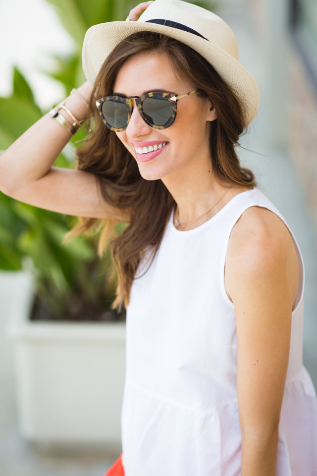 white blouse with orange shorts and panama hat vacation style M Loves M @marmar