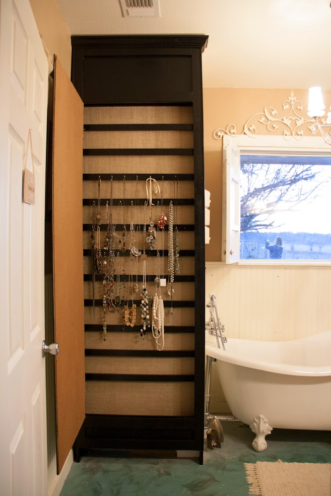 Organize jewelry to hide an unsightly water heater :: OrganizingMadeFun.com