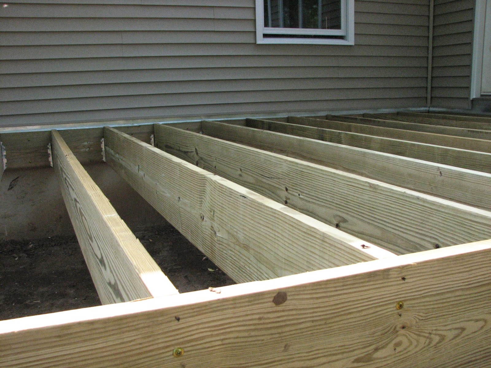 Stitches of violet insulation and deck joists for Balcony joists