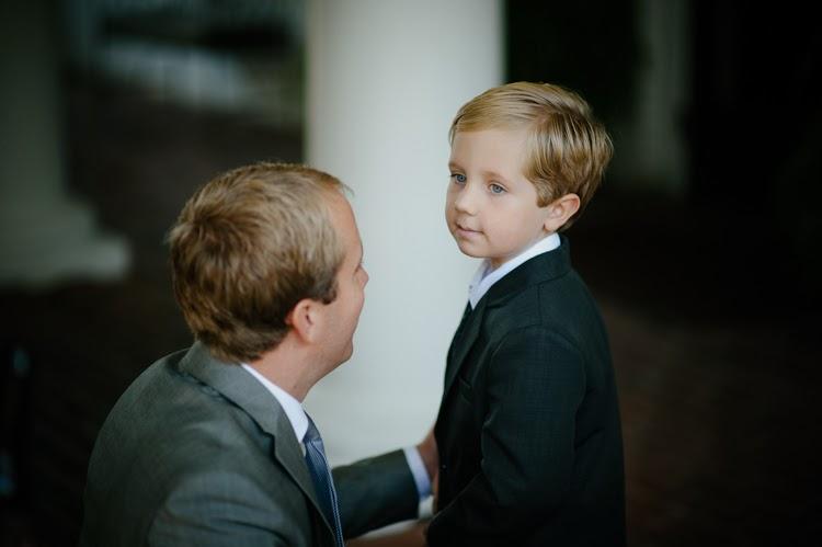 ring bearer looking at his dad
