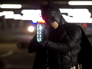 Batman comes prepared for battle © 2012 Warner Bros. Entertainment Inc. and Legendary Pictures Funding, LLC