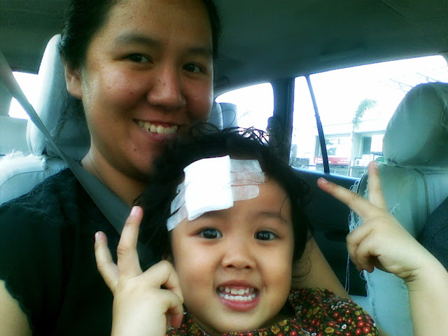 Kecil with bandage on her forehead