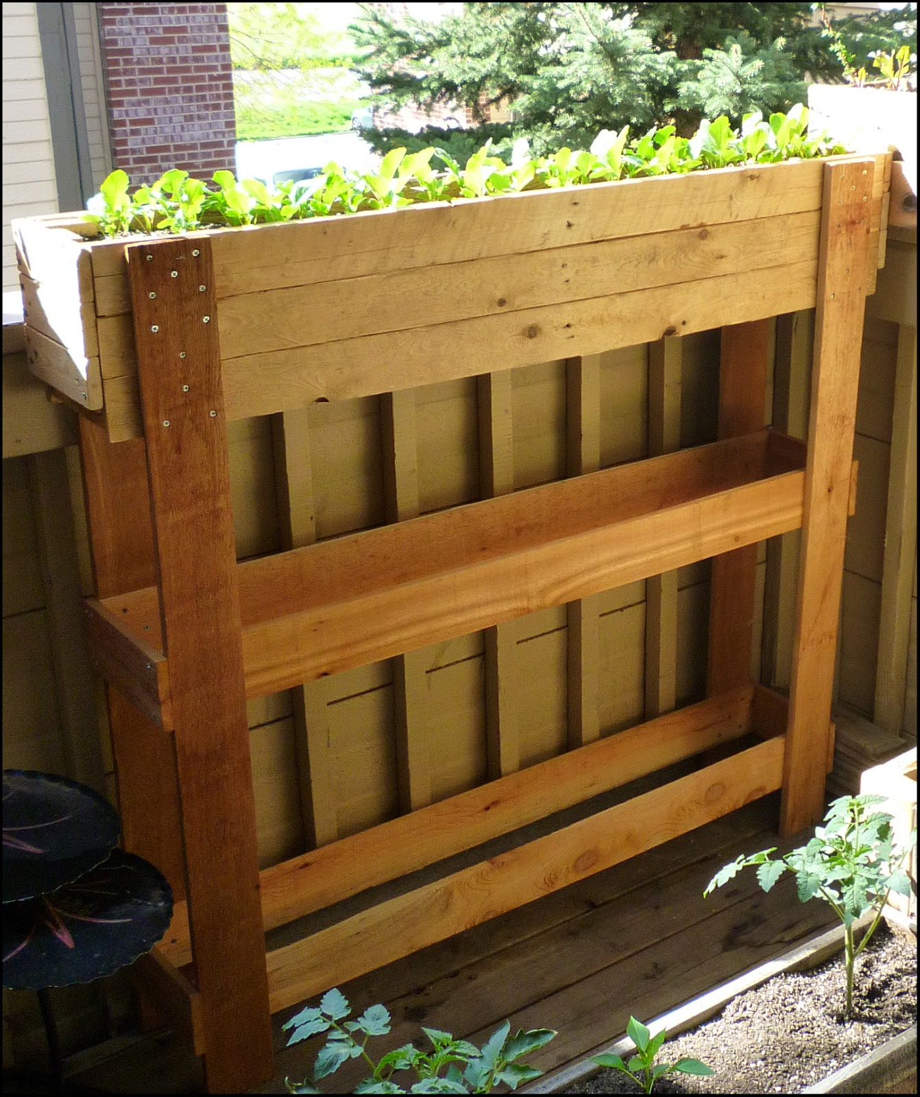 Patio of pots pallet planters a reclaiming project for Making planters from pallets