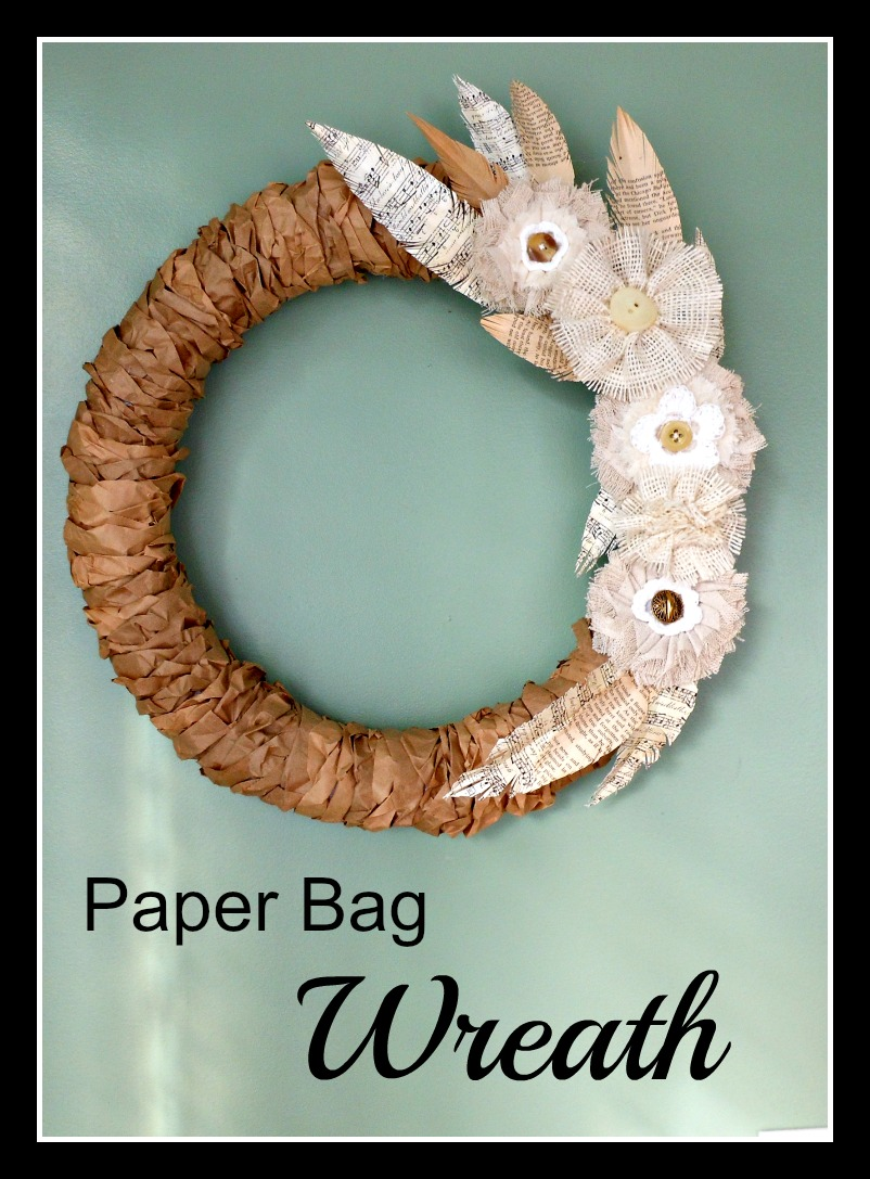Vintage, Paint and more... rustic wreath made with styrofoam form, brown paper lunch bags, book page feathers and burlap and lace flowers