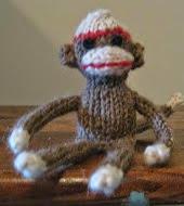 http://www.ravelry.com/patterns/library/tiny-sock-monkey