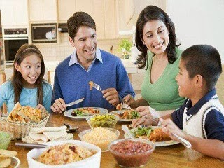 A family having a happy dinner conversation.