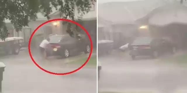 Γυναίκα πλένει το αυτοκίνητο της ενώ ο τυφώνας Ίρμα διαλύει τα πάντα γύρω της