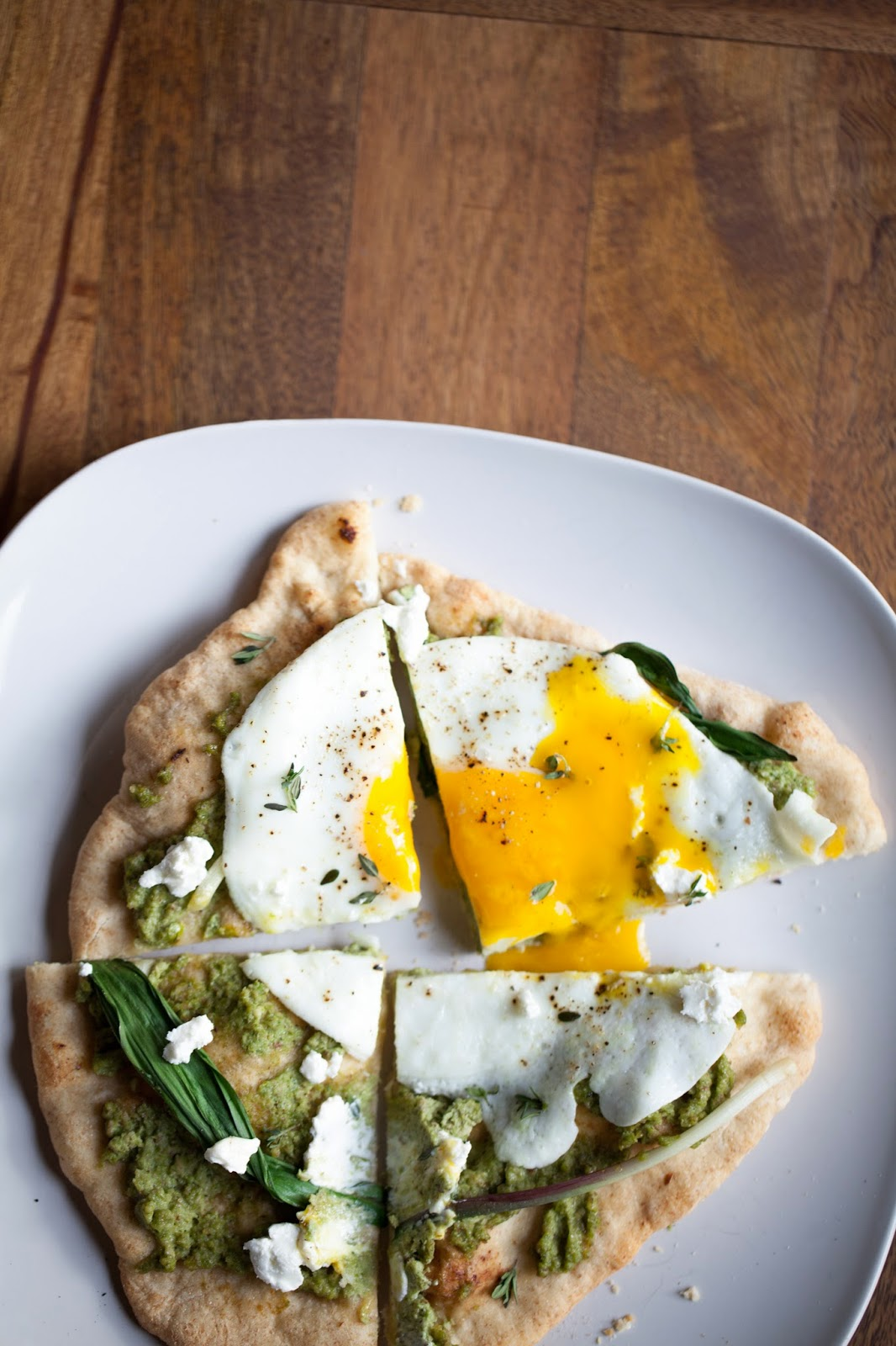 Spring Pizza with asparagus pesto, ramps, fried egg, goat cheese and thyme