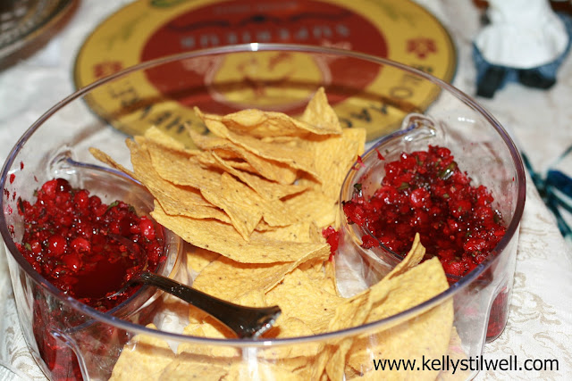 Cranberry salsa in a clear bowl with chips.