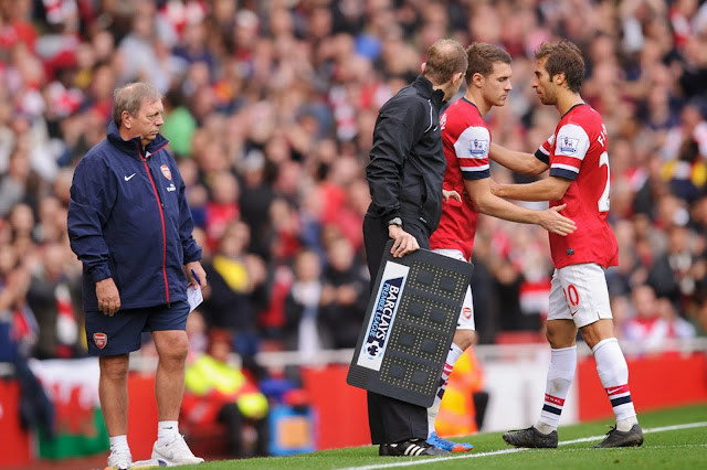 Mathieu Flamini goes off injured against Norwich, 19 October 2013